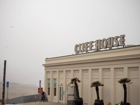 Cliff House restaurant sign and building on foggy day Sajtókép