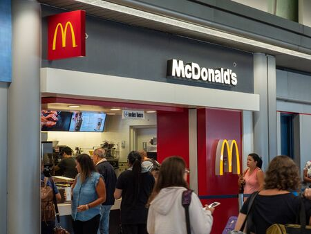 Crowd lining up outside McDonalds restaurant at airport