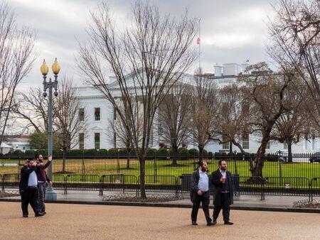 Jewish men and rabbis walking past White House Editorial
