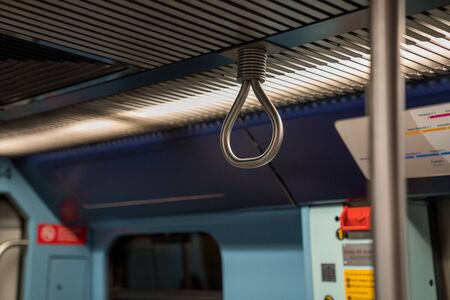Steel handle safety and stability bar in public transit subway system