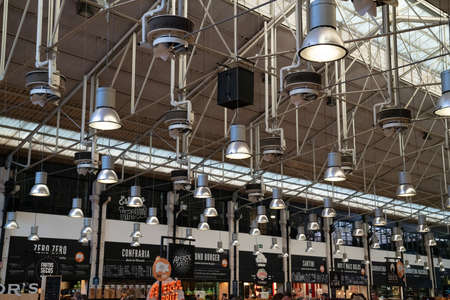 high ceilings and lights at Time Out Market Lisbon Editorial