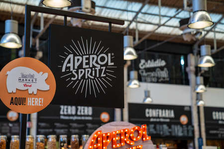 Aperol Spritz logo at specialty bar at Time Out Market Lisbon Editorial