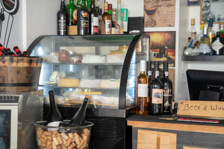 Wine and cheese on display in sleepy wine bar