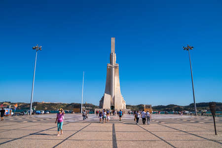 Padrao dos Descobrimentos plaza with tourists walking Editorial