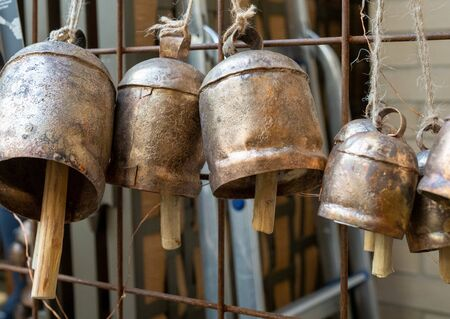 Lantern gong style bells hanging by string on wall on sale