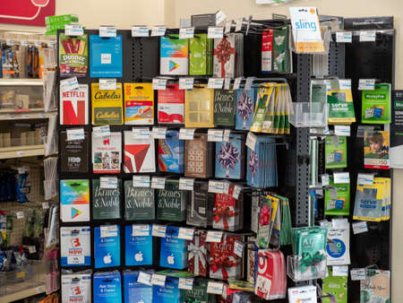 Gift card stand in convenience store with Apple, Google, Delta, HBO, and more