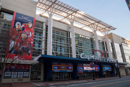 Capital One Arena entrance with advertisement of Caps hockey team