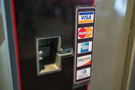 Visa, MasterCard, American Express, Discover, Diners Club credit card reader payment slot Editorial
