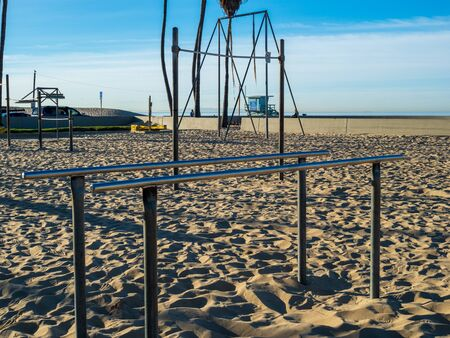 Gymnastics and exercise parallel bars on beach in an outdoor gym