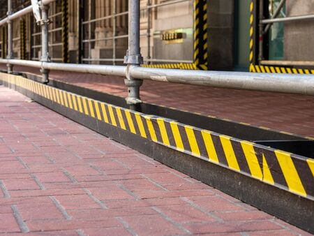 Yellow warning tape on construction scaffolding outside of a building