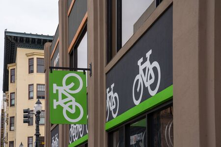 Bike symbols outside of storefront parking location in urban environment