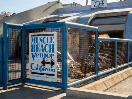 Muscle Beach Venice California sign in front of muscle beach gym equipment Editorial