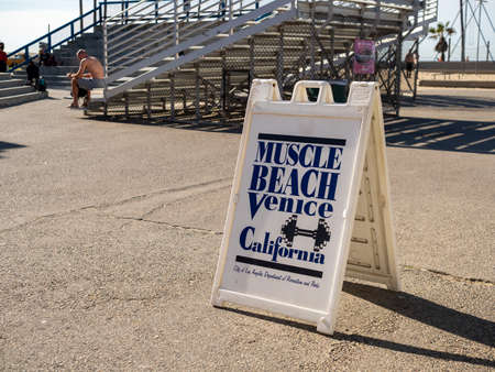 Muscle Beach Venice Beach signboard with bleachers in background