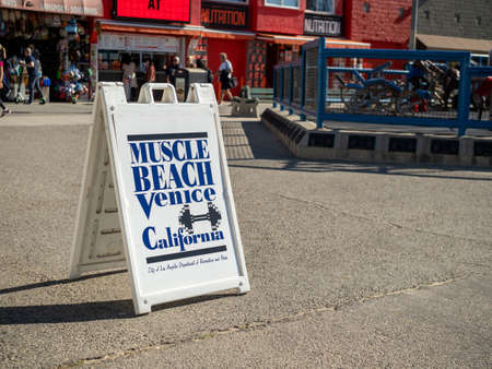 Muscle Beach Venice Beach signboard next to outdoor destination gym