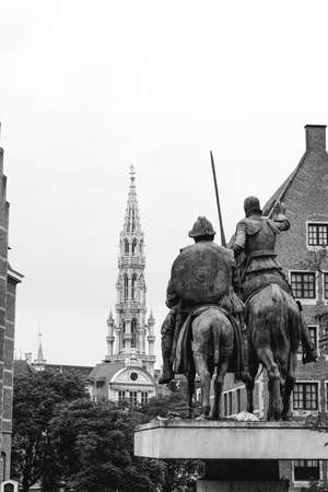 Statue of Don Quixote and Tower of the Town Hall in Brussels, Belgium