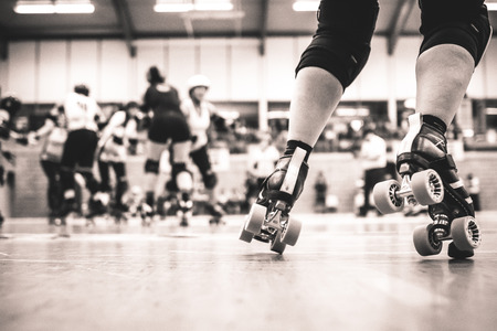 Legs of a roller derby player during an international competition