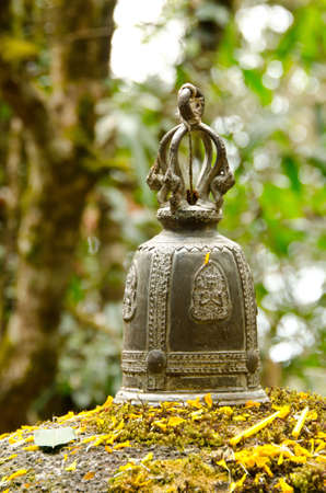 bell bronze bell: A bronze bell in a forest in Thailand
