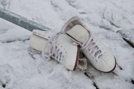 iceskates: Woman ice-skates standing on the snow