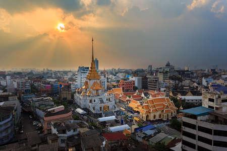 Aerial view cityscape & Sunbeam Wat Traimit (Thai Temple) Inside of there have Golden Buddha that the biggest in the world in chinatown or yaowarat area in bangkok, Thailand.