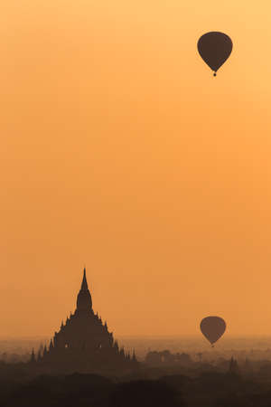 Beautiful sunrise in Bagan Archaeological Zone & Hot air balloons fly over the Buddhist temples at sunrise in Bagan, Myanmar. This temple town is one of Myanmar main attractions.