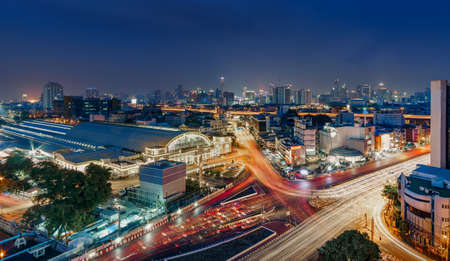 The central train station in Bangkok (Hua Lamphong Railway Station,MRT) & traffic in front of Hualamphong Train Station at twilight Bangkok, Thailand, long exposure image Stock Photo