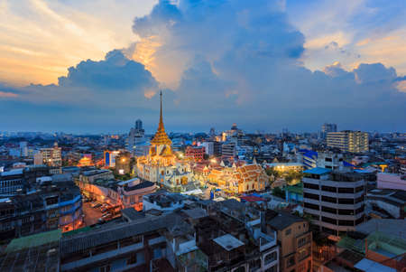 Aerial view cityscape Wat Traimit (Thai Temple) Inside of there have Golden Buddha that the biggest in the world in chinatown or yaowarat area at sunset in bangkok, Thailand. Stock Photo