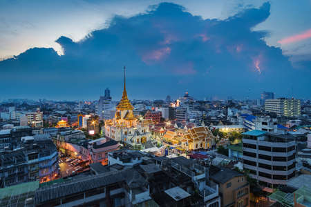 Aerial view cityscape & lightning Wat Traimit (Thai Temple) Inside of there have Golden Buddha that the biggest in the world in chinatown or yaowarat area in bangkok, Thailand. Editorial
