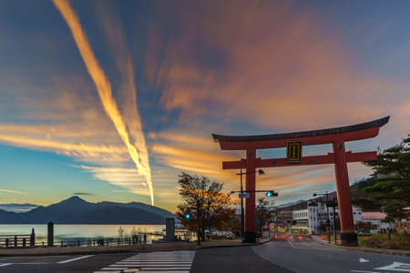 Lake Chuzenji with Torii in Nikko national park in Japan Beautiful tourist attractions that show the culture, traditional at beautyful sky time, twilight or sunset