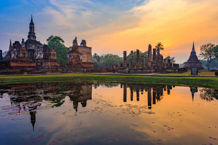 Ruins of the temple of Wat Mahathat Temple in the precinct of Sukhothai Historical Park, Evening in the historical park of Sukhothai city. Thailand Stock Photo