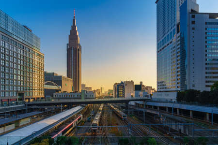 Cityscape around railway Shinjuku Station with NTT Docomo Yoyogi Building, Shinjuku is one of Tokyos business districts. There are many skyscrapers, such as Hotels, office buildings.