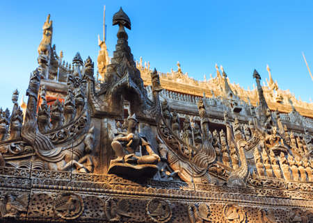 Carvings on top of Shwenandaw Kyaung Temple or Golden Palace Monastery, also known as the Teak Temple, features traditional burmese architecture in Mandalay, Myanmar