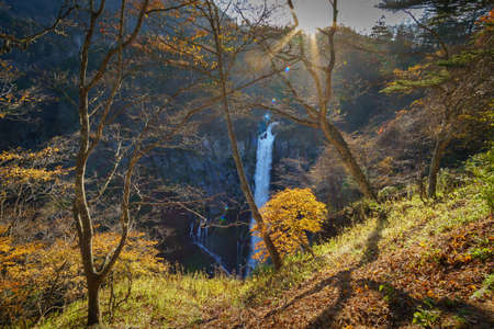 Ryuzu Fall (Dragon Head Fall), The famous travel destination in Nikko National with autumn foliage and sunlight. The upper part of Ryuzu Falls,Nikko,Tochigi Prefecture,Japan Stock Photo