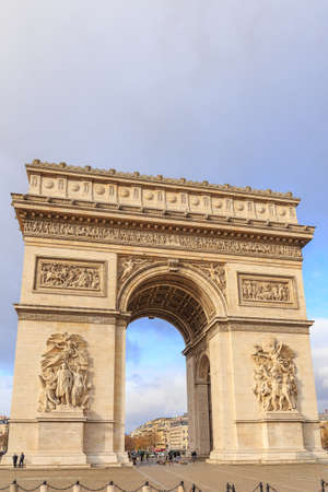 PARIS, FRANCE - The Arc de Triomphe de lEtoile is one of the most famous monuments, View of the Champs-Elysees Avenue is full of stores, cafes and restaurants. Stock Photo