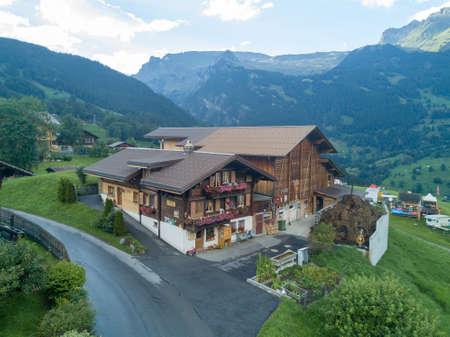 Beautiful chalet cabin in Swiss mountain village Grindelwald, Swiss Alps Stock Photo