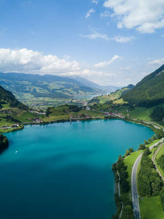 Beautiful aerial drone shot view of Lake Lungernersee in summer time, in Swiss Alps