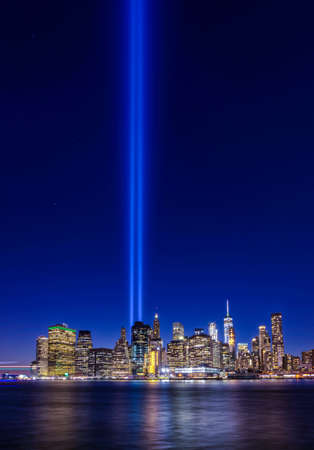 Clear view from Brooklyn of 911 memorial tribute light in Manhattan, New York City Stock Photo