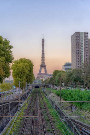 Sunset view of Eiffel tower with railway in west Paris in autumn Stock Photo