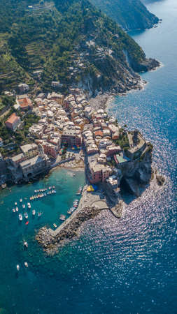 Aerial drone shot view of Vernazza port in Cinque Terre, Italy