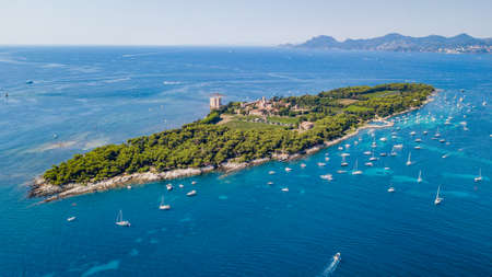 Aerial drone shot view of yachts between Ile Sainte Marguerite and Ile Saint Honorat in mediterranean sea Stok Fotoğraf