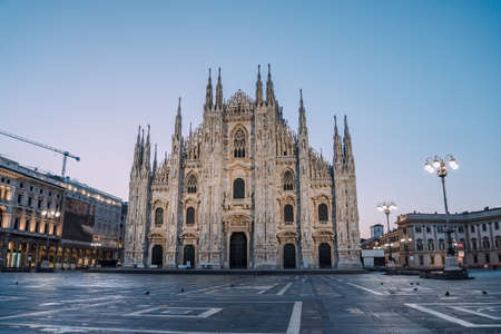 Early morning view of Milano Duomo Cathedral with pigeons in Milan, Italy