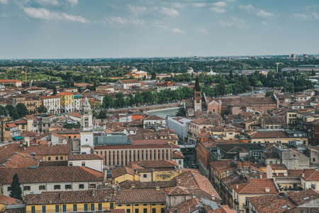 Top view of red brick city skyline from torre dei lamberti tower in Verona, Italy