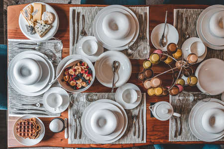 overheads shot of homemade brunch with food and macarons in unique porcelaine plate Фото со стока