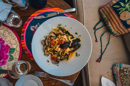 Typical local food, seafood pasta in Positano, Amalfi Coast in Italy Stock Photo