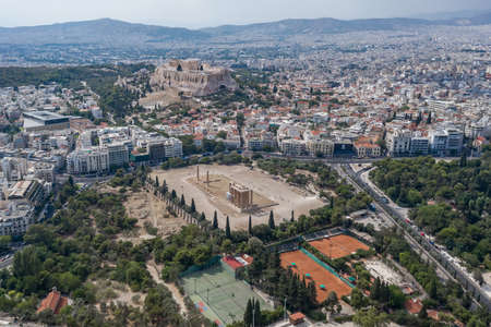 Aerial drone shot of Acropoli of Athens, museum and Zeus Olympion Temple collumn ruins Stok Fotoğraf
