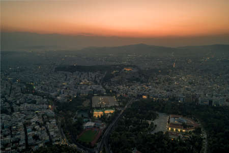 Aerial drone shot of Acropolis of Athens and its surroundings during sunset before evening