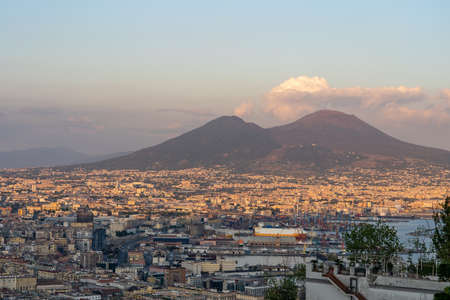 Sunset view of Mont Vesuvius volcano with Naples city in the foreground