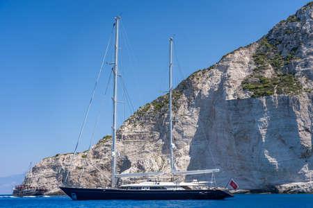 Zakynthos, Greece - August 20, 2019: Luxury yacht parked in Ionian sea near shipwreck bay, Navagios beach in summer noon