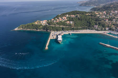 Aerial drone shot of cars embarking on big cruise ship at Poros town harbour of Kefalonia Island Stock Photo