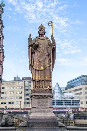 The historic bishop Ansgar statueon Trostbrucke bridge in Hamburg, Germany