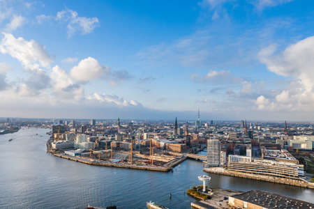 Aerial drone view of Port of Hamburg near Hafencity after storm with blue sky